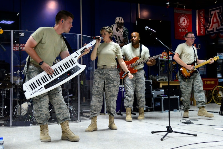 The U.S. Air Forces Central Command band performs for service members at an undisclosed location in Southwest Asia July 6, 2015. The band utilized music as a form of communication to boost morale. (U.S. Air Force photo/Senior Airman Racheal E. Watson)