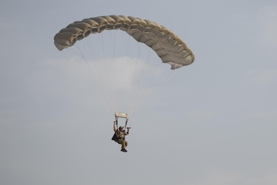 A U.S. Air Force Pararescueman with a Guardian Angel team assigned to the 83rd Expeditionary Rescue Squadron parachutes to the ground during High Altitude Low Opening jump training at Bagram Airfield, Afghanistan, July 18, 2015. The 83rd ERQS mission is to rescue, recover, and return American or allied forces in times of danger or extreme duress. (U.S. Air Force photo by Tech. Sgt. Joseph Swafford/Released)