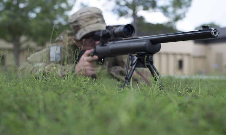 Staff Sgt. Joseph Crotty, the 822d Base Defense Squadron NCO in charge of standards and evaluations, gazes down the sights of his M24 Sniper Weapon System while in the prone position July 2, 2015, at Moody Air Force Base, Ga. Crotty and Senior Airman Phillip Hopkins, the 822d Base Defense Squadron fireteam leader, attended the nine-week Royal Air Force's Basic Sniper Course to develop their knowledge and skills. (U.S. Air Force photo/Staff Sgt. Eric Summers Jr.)
