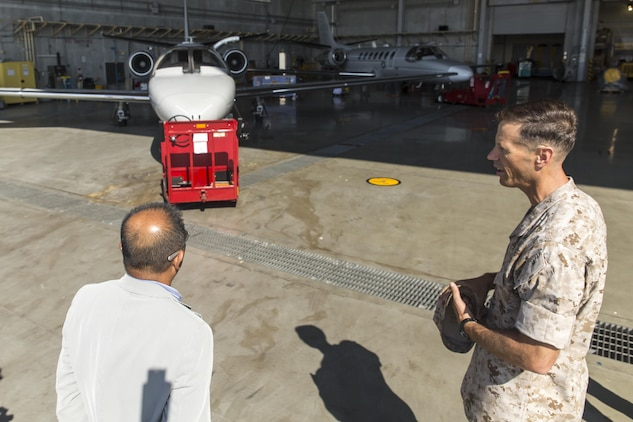 Toshiyuki Kuwabara, left, chairman of the Iwakuni City Council, listens to Lt. Col. James Hurd, right, executive officer for Marine Corps Air Station Futenma, Japan, explains the use of the UC-35D Cessna during a visit to the air station to conduct a study tour, July 16, 2015. Iwakuni City Council, Chugoku Shikoku Defense Bureau officials, Okinawa Defense Bureau officials and Ginowan City Council members visited MCAS Futenma to help deepen the their understanding on national security here, and the mission of MCAS Futenma in support of III Marine Expeditionary Force's aviation warfighting capabilities.