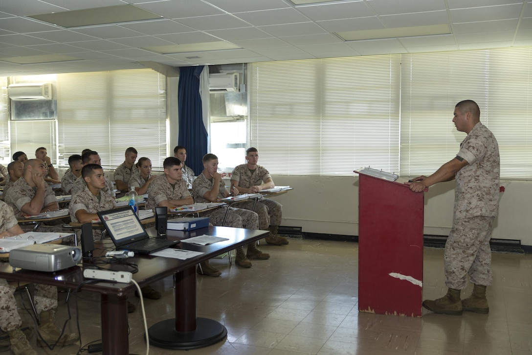 Staff Sgt. Salomen Cumpian, a motor transport maintenance chief with Marine Tactical Air Command Squadron 18, with 1st Marine Wing Aircraft, III Marine Expeditionary Unit, lectures Marines during a career progression class during the Futenma Corporal's Course, July 15, 2015, aboard Marine Corps Air Station Futenma, Okinawa, Japan, Marine Corps Installations Pacific. This is the fifth course of this year. The class started July 13, 2015, and is scheduled to graduate July 31, 2015.