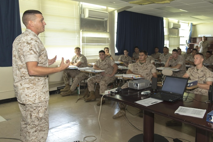 Staff Sgt. Neil Foose Jr., deputy director of Corporal's Course aboard Marine Corps Air Station Futenma, Okinawa, Japan, Marine Corps Installations Pacific, debriefs Marines after they received a class on career progression during the Futenma Corporal's Course, July 15, 2015, aboard MCAS Futenma. This is the fifth course of this year. The class started July 13, 2015, and is scheduled to graduate July 31, 2015. Foose from Rochester, New York, is also the ground and electronics maintenance chief with Marine Air Control Squadron 4, 1st Marine Air Wing, III Marine Expeditionary Unit.