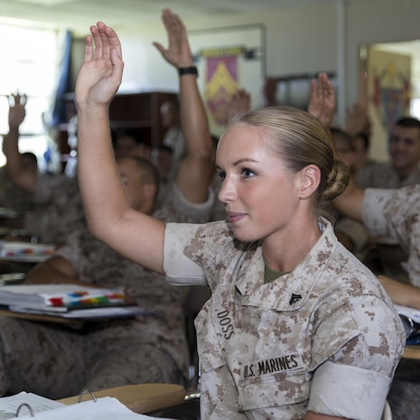 Cpl. Sonja Doss, 4th squad leader for Corporal's Course class 537-15, answers a question during a career progression class during the Futenma Corporal's Course, July 15, 2015, aboard Marine Corps Air Station Futenma, Okinawa, Japan. This is the fifth course for the year. The class started July 13, 2015, and is scheduled to graduate July 31, 2015. Doss is from Kaufman, Texas.
