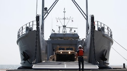 The ramp on the Landing Craft Utility 2000 is lowered and unloading of vehicles begins at Anmyeon Beach, Republic of Korea. CJLOTS 2015 is an exercise designed to train U.S. and ROK service members to accomplish vital logistical measures in a strategic area while strengthening communication and cooperation in the U.S. - ROK Alliance.