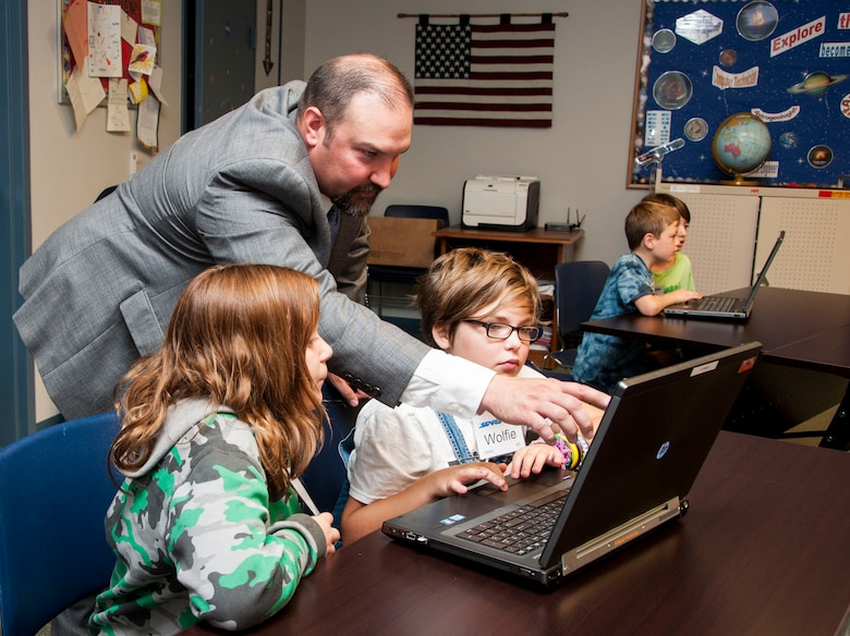 Volunteers from the U.S. Army Corps of Engineers Middle East District's information management team worked with rising 5th grade students at STARBASE Academy Winchester July 16 to explore some aspects of IM careers.