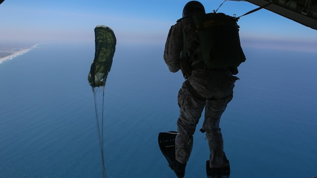 Marines assigned to Company A, 1st Marine Reconnaissance Battalion, 1st Marine Division, perform parachute jumps into the ocean at Marine Corps Base Camp Pendleton, California, July 15, 2015. The Marines and Sailors conducted low-level static-line parachute operations with intentional water landings to make insertions, where other means such as boats or high-altitude parachute jumps may not be available.