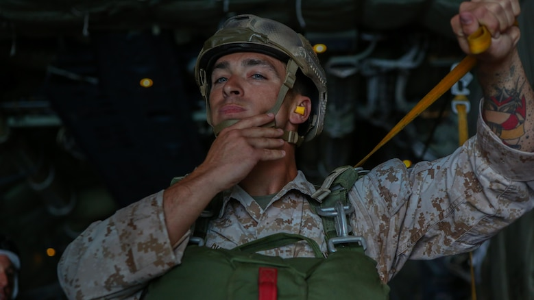 A Marine assigned to Company A, 1st Marine Reconnaissance Battalion, 1st Marine Division, conducts his final gear inspections before performing a parachute jump into the ocean at Marine Corps Base Camp Pendleton, California, July 15, 2015.  The Marines and Sailors conducted low-level static-line parachute operations with intentional water landings to make insertions, where other means such as boats or high-altitude parachute jumps may not be available.