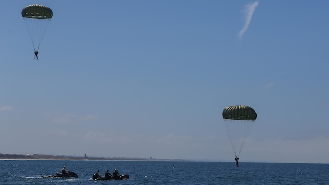 Marines assigned to Company A, 1st Marine Reconnaissance Battalion, 1st Marine Division, perform parachute jumps into the ocean at Marine Corps Base Camp Pendleton, California, July 14, 2015.  The Marines and Sailors conducted low-level static-line parachute operations with intentional water landings to make insertions, where other means such as boats or high-altitude parachute jumps may not be available.