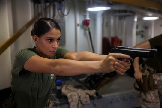 U.S. Marine Cpl Justine Woodend practices dry-fire drills with an M9 Beretta pistol aboard the amphibious assault ship USS Essex (LHD 2). Woodend is a motor transportation operator with Combat Logistics Battalion 15, 15th Marine Expeditionary Unit. Dry-fire drills help the Marines focus on the fundamentals of marksmanship. The 15th MEU is embarked on the Essex Amphibious Ready Group and deployed to maintain regional security in the U.S. 5th Fleet area of operations.