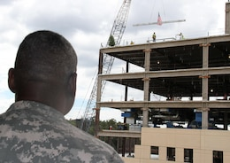 "Officials from Fort Benning, Army Medical Command, the U.S. Army Corps of Engineers, Savannah district, and Turner Construction celebrated the placement of the last steel beam on the Martin Army Community Hospital project with a ""topping out"" ceremony, Sept. 14, 2012."