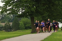 Recruiting Station Detroit's female Marine poolees conduct a 1.5 mile run during the bi-annual female pool function at the Boys and Girls Club of Troy, Michigan, June 20, 2015. The ladies started the day off with an Initial Strength Test that includes three events: pull-ups or a flexed arm hang, crunches, and a timed run. (U.S. Marine Corps photo by Cpl. J.R. Heins/Released)
