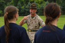 U.S. Marine Corps Staff Sgt. Jason Varnadoe, a native of Lubricity, Georgia, and drill instructor at Marine Corps Recruit Depot, Parris Island, South Carolina, introduces himself to the female poolees of Recruiting Station Detroit during the bi-annual female pool function at the Boys and Girls Club of Troy, Michigan, June 20, 2015. Varnadoe taught the ladies basic drill movements to help prepare them for the standards of recruit training.  (U.S. Marine Corps photo by Cpl. J.R. Heins/Released)