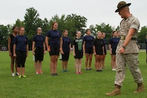 U.S. Marine Corps Staff Sgt. Jason Varnadoe, a native of Lubricity, Georgia, and drill instructor at Marine Corps Recruit Depot, Parris Island, South Carolina, instructs the female poolees of Recruiting Station Detroit during the bi-annual female pool function at the Boys and Girls Club of Troy, Michigan, June 20, 2015. Varnadoe taught the ladies basic drill movements to help prepare them for the standards of recruit training.  (U.S. Marine Corps photo by Cpl. J.R. Heins/Released)