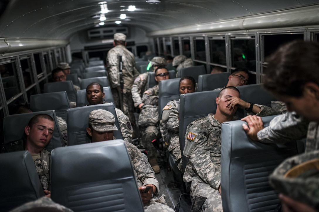 "U.S. Army Reserve Combat Engineer Soldiers from the 374th Engineer Company (Sapper), headquartered in Concord, Calif., take a break on a bus after completing a night land navigation course through the hills and mountains of Camp San Luis Obispo Military Installation, Calif., July 15, during a two-week field exercise known as a Sapper Leader Course Prerequisite Training. The land navigation course began after dark and most Soldiers didn't finish until after midnight after trekking for miles through the steep California hills. The unit is grading its Soldiers on each event to determine which ones will earn a spot on a ""merit list"" to attend the Sapper Leader Course at Fort Leonard Wood, Mo. (U.S. Army photo by Master Sgt. Michel Sauret)"