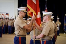 U.S. Marine Corps Maj. Christopher S. Conner, right, relinquishes command of Recruiting Station Baltimore to Maj. Jason C. Copeland during a change of command ceremony at Fort George G. Meade, Maryland, June 18, 2015. Conner, a native of Gastonia, North Carolina, served as the commanding officer of RS Baltimore for three years during which time the Marines under his command succeeded in contracting 2,168 men and women into the Marine Corps. Copeland, a native of Roswell, New Mexico, previously served as the operations officer for 2nd Battalion, 5th Marine Regiment, before being selected as the commanding officer of RS Baltimore.  (U.S. Marine Corps photo by Cpl. Tyler Birky/Released)