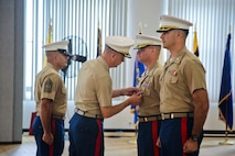 U.S. Marine Corps Col. John A. Bolt, the commanding officer of 4th Marine Corps Recruiting District, awards a Meritorious Service Medal to Maj. Christopher S. Conner, the outgoing commanding officer of Recruiting Station Baltimore during a change of command ceremony at Fort George G. Meade, Maryland, June 18, 2015. Conner, a native of Gastonia, North Carolina, served as the commanding officer of RS Baltimore for three years during which time the Marines under his command succeeded in recruiting 2,168 men and women into the Marine Corps. (U.S. Marine Corps photo by Cpl. Tyler Birky/Released)