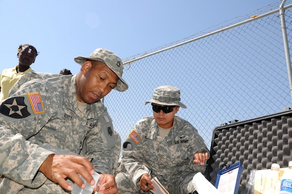 Army Sgt. 1st Class Stanley Martin, senior enlisted leader of the 125th Reverse Osmosis Water Purification Unit, and Army 2nd Lt. Danielle Golden, the 125th's mission commander in Haiti, test the well water for impurities at a school in Gonaives, Haiti, May 16, 2011. Task Force Bon Voizen, New Horizons Haiti 2011, is a U.S. Southern Command sponsored, U.S. Army South conducted, joint foreign military interaction/humanitarian exercise under the command of the Louisiana National Guard. Task Force Bon Voizen is deploying U.S. military engineers and medical professionals to Haiti for training and to provide humanitarian services.
