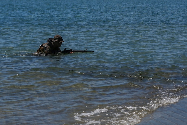A reconnaissance Marine with 1st Reconnaissance Battalion, 1st Marine Division, demonstrates amphibious capabilities to Devil Pups aboard Marine Corps Base Camp Pendleton, Calif., July 12, 2015. After the demonstration, the Marines held a question and answer session for the students who wanted to know more about the reconnaissance community. (U.S. Marine Corps photo by Cpl. Will Perkins)