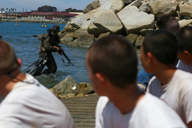 A reconnaissance Marine with 1st Reconnaissance Battalion, 1st Marine Division, demonstrates 1st Recon's amphibious capabilities to Devil Pups aboard Marine Corps Base Camp Pendleton, Calif., July 12, 2015. After the demonstration, the Marines held a question and answer session for the students who wanted to know more about the reconnaissance community. (U.S. Marine Corps photo by Cpl. Will Perkins)