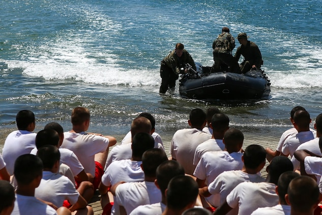 Reconnaissance Marines with 1st Reconnaissance Battalion, 1st Marine Division, demonstrate amphibious capabilities to Devil Pups aboard Marine Corps Base Camp Pendleton, Calif., July 12, 2015. After the demonstration, the Marines held a question and answer session for the students who wanted to know more about the reconnaissance community. (U.S. Marine Corps photo by Cpl. Will Perkins)