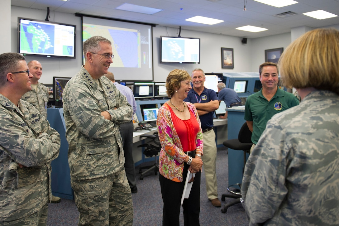 Gen. John Hyten, commander, Air Force Space Command, his wife Laura, and Col. Shawn Fairhurst, 45th Space Wing vice commander, left, speak with members of the 45th Weather Squadron about what they do during launches July 15, 2015, at the Morrell Operations Center. The 45th Space Wing hosted the general, his wife, Laura, and Chief Master Sgt. Douglas McIntyre, the AFSPC Command Chief, as the wing prepared for the launch of the Global Positioning System IIF-10. (U.S. Air Force photo/Matthew Jurgens) (Released)