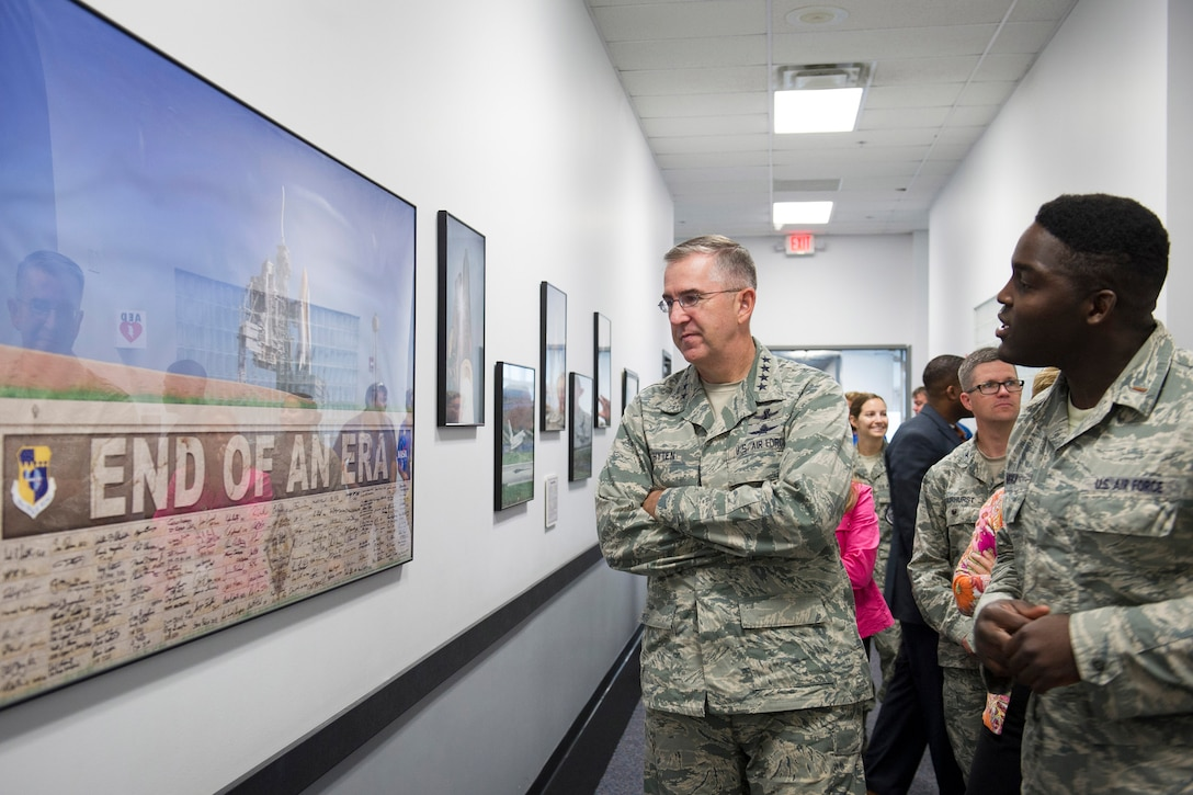 Gen. John Hyten, commander, Air Force Space Command, listens as 2nd Lt. Moshood Adeniji, 1st Range Operations Squadron, gives him a tour of the Morrell Operations Center July 15, 2015, at Cape Canaveral Air Force Station. The 45th Space Wing hosted the general, his wife, Laura, and Chief Master Sgt. Douglas McIntyre, the AFSPC Command Chief, as the wing prepared for the launch of the Global Positioning System IIF-10. (U.S. Air Force photo/Matthew Jurgens) (Released)