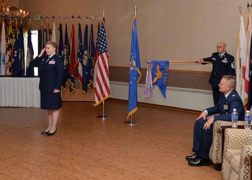 Maj. Erin Hancock, the incoming 354th Force Support Squadron commander, receives her first salute from her squadron July 17, 2015, at Eielson Air Force Base, Alaska. Hancock was previously a congressional liaison officer, House of Representatives Liaison Office, Office of Legislative Liaison, Secretary of the Air Force, Pentagon, Washington D.C. (U.S. Air Force photo by Staff Sgt. Shawn Nickel/Released)