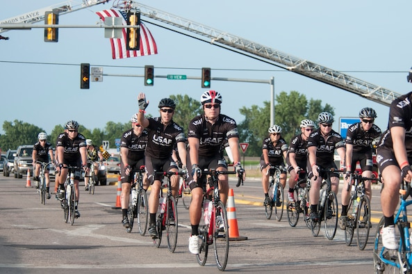 "Members of the Air Force cycling team begin the first leg of the ""Registers Annual Great Bike Ride Across Iowa"" (RAGBRAI) in Sioux City, Iowa, on July 19, 2015. RAGBRAI participants will travel nearly 500-miles during the weeklong event, beginning in the western side of the state in Sioux City and ending in the Quad Cities in Davenport, Iowa, along the Mississippi river.