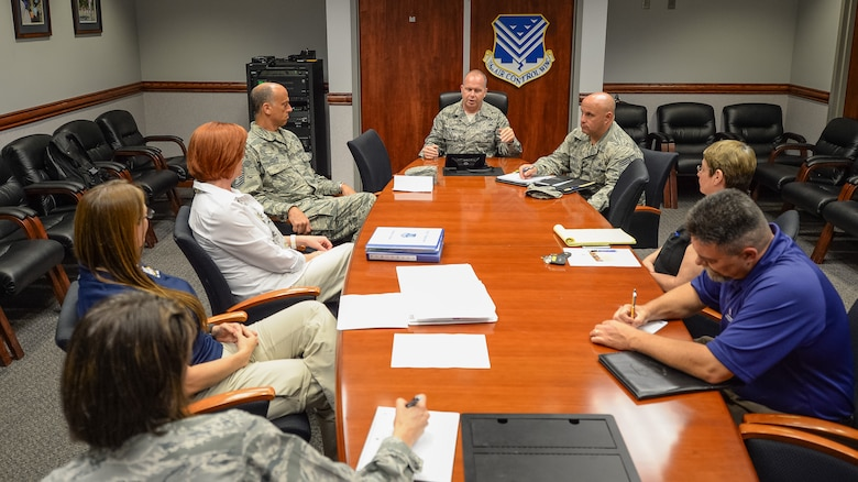 U.S. Air Force Chief Master Sgt. James W. Hotaling, Air National Guard command chief, talks with leaders from the 116th Air Control Wing (ACW), Georgia Air National Guard, Family Readiness, Psychological Health, Yellow Ribbon, Wing Chief of Staff, Public Affairs and the 116th ACW command chief about resiliency and how their departments are doing during a visit to Robins Air Force Base, Ga., July 16, 2015. During his visit, Hotaling conducted two town hall style meetings and met with key enlisted leadership councils and Airmen resiliency representatives. His time with the Airmen focused on sharing his message of a renewed commitment to the profession of arms, health of the force, and recognition of our Airmen and accomplishments. The visit offered the opportunity for Airmen in the wing to meet their top leader, share their concerns and gain perspective from the national level. (U.S. Air National Guard photo by Tech. Sgt. Regina Young/Released)