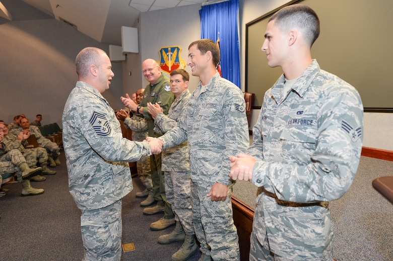 U.S. Air Force Chief Master Sgt. James W. Hotaling, Air National Guard command chief, recognizes five Airmen from the 116th Air Control Wing, Georgia Air National Guard, for their accomplishments during an enlisted all call at Robins Air Force Base, Ga., July 16, 2015. During his visit, Hotaling conducted two town hall style meetings and met with key enlisted leadership councils and Airmen resiliency representatives. His time with the Airmen focused on sharing his message of a renewed commitment to the profession of arms, health of the force, and recognition of our Airmen and accomplishments. The visit offered the opportunity for Airmen in the wing to meet their top leader, share their concerns and gain perspective from the national level. (U.S. Air National Guard photo by Tech. Sgt. Regina Young/Released)