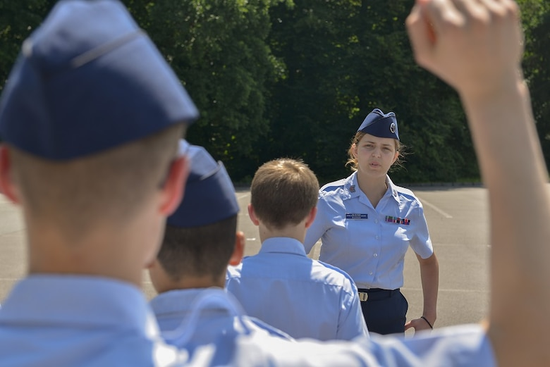 Abigail Murray, Civil Air Patrol cadet, answers another cadet's question in a drill and ceremony test during the CAP's 2015 European Summer Camp June 24, 2015, at Ramstein Air Base, Germany. Murray served as an NCO in charge during the test and led one of the two groups testing. (U.S. Air Force photo/Airman 1st Class Lane T. Plummer)