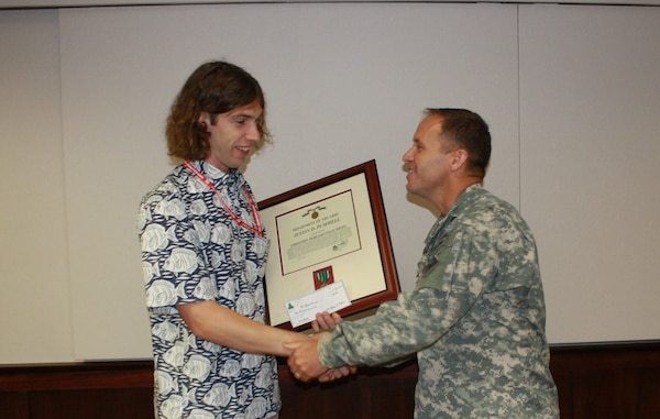 "Mr. Justin Pummell (l) is presented a ""Commanders Award for Civilian Service"" from Brigadier General Jeff Milhorn for his efforts in support of USACE recovery operations following the 24 April 2015 earthquake in Nepal."
