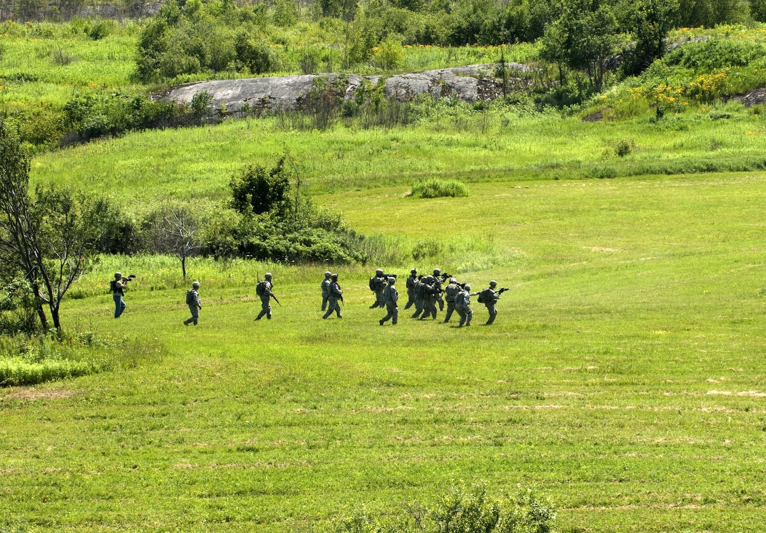 New York Army National Guard Soldiers assigned to Company B 2nd Battalion 108th Infantry move onto the objective during a platoon live-fire exercise at Fort Drum, New York, on July 16, 2015. The training is part of an Exportable Combat Training Capability (XCTC) exercise, required the coordination of the entire platoon, and provided the unit's Soldiers with an opportunity to improve their combat techniques.