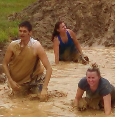 """Naval Surface Warfare Center Dahlgren Division (NSWCDD) Systems Safety Engineering Division personnel - known as the """"Mud Crazy G70 Team"""" - ran a challenging four mile-long obstacle course, raising funds for local children, families and residents June 27."""