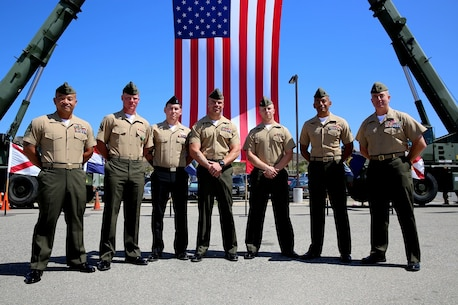 Marines and a Sailor with 2nd Battalion, 4th Marines, 1st Marine Division, pose for a photo after a 2/4 Association ceremony aboard Marine Corps Base Camp Pendleton, California, July 17, 2015. Four Marines and a Sailor were presented with awards by the 2/4 Association liaison, Col. Jim Williams (Ret.).