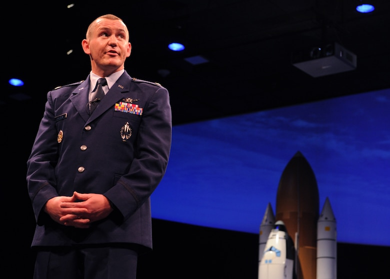 Maj. Benjamin Calhoon, the chief of the Positioning, Navigation and Timing Branch within the Space Operations Division of Headquarters Air Force, gives a GPS lecture at the Smithsonian's National Air and Space Museum in Washington D.C., July 17, 2015. The Air Force celebrated the 20th anniversary of the GPS. (U.S. Air force photo/Staff Sgt. Whitney Stanfield)