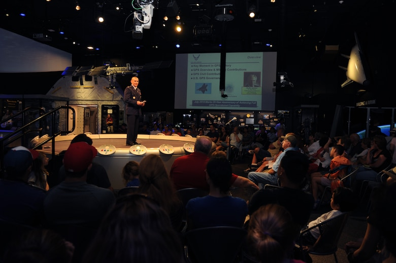 Maj. Benjamin Calhoon, the chief of the Positioning, Navigation and Timing Branch within the Space Operations Division of Headquarters Air Force, gives a GPS lecture at the Smithsonian's National Air and Space Museum in Washington D.C., July 17, 2015. The GPS was invented by the Department of Defense; it's a constellation of orbiting satellites that provides navigation data to military and civilian users all over the world. (U.S. Air force photo/Staff Sgt. Whitney Stanfield)