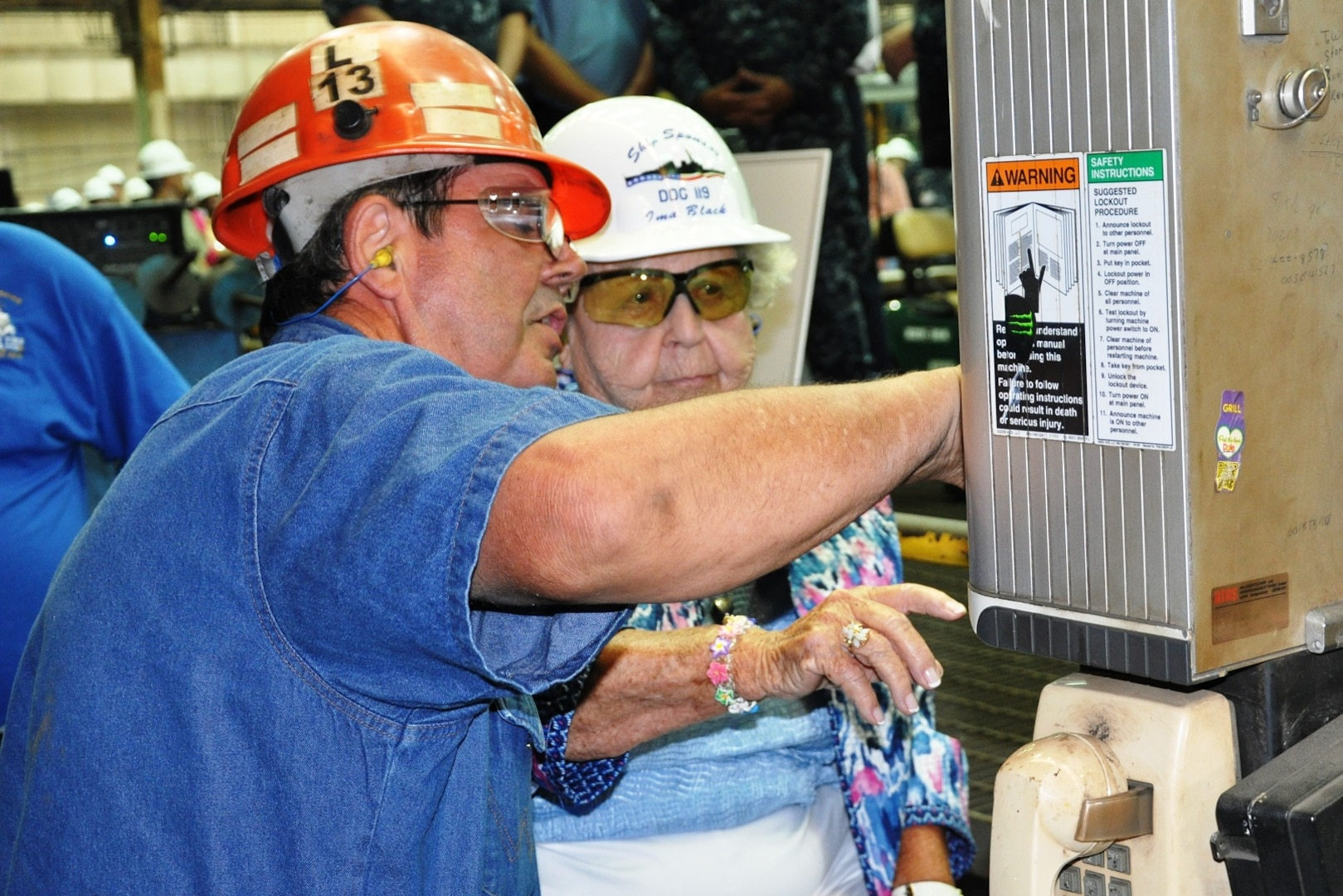 150721-N-EW716-001 (July 21, 2015) PASCAGOULA, Miss. - Mrs. Ima Black, widow of the first Master Chief Petty Officer of the Navy, Delbert Black, begins the mechanized process of cutting the steel plate with the help of Paul Bosarge, Huntington Ingalls Industries burner/work leader.  Mrs. Black is the sponsor for the destroyer DDG 119 -- the future USS Delbert D. Black -- which formally started fabrication in Ingalls' Pascagoula, Miss., shipyard today.