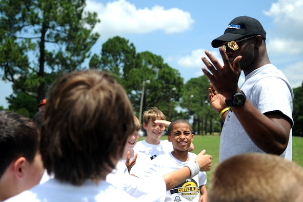 Cortez Allen, the Pittsburgh Steelers defensive back, hypes up young athletes at the start of a National Football League ProCamp, July 16, 2015, at Seymour Johnson Air Force Base, N.C. The free, two-day camp instilled leadership and teamwork skills into children. (U.S. Air Force photo/Senior Airman Ashley J. Thum)