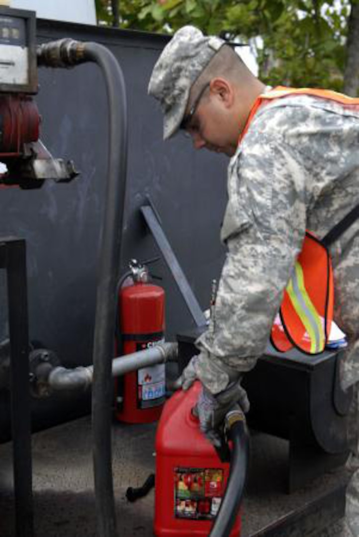 Army Spc. Eric Sierra, a Puerto Rican National Guard Soldier assigned to the 191st Readiness Support Company, pumps fuel into a gas can for vehicles in support of the Fuerzas Comando 2011 competition June 13, 2011. Fuerzas Comando, established in 2004, is a U.S. Southern Command-sponsored special operations skills competition and senior leader seminar which is conducted annually in Central and South America and the Caribbean and is scheduled to run June 15-23.