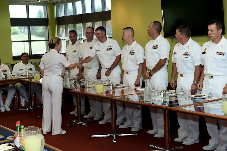 Vice Adm. Robin R. Braun, Chief of Navy Reserve and Commander, Navy Reserve Force, greets members of the Chief's Mess before lunch July 19, 2015, at the Panthers Den on Buckley Air Force Base, Colo. This event was part of Braun's visit to the Navy Operations Support Center, Denver, one of several visits to Front Range Navy Reserve units celebrating the Navy Reserve Corps' 100th anniversary.  (U.S. Air Force photo by Senior Airman Phillip Houk/Released)