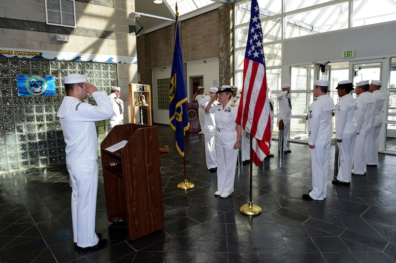 Members of the Navy Operations Support Center, Denver, ring aboard Vice Adm. Robin R. Braun, Chief of Navy Reserve and Commander, Navy Reserve Force July 19, 2015, on Buckley Air Force Base, Colo. This visit was held as part of the yearlong celebration by the Navy Reserve Corps to celebrate their 100th anniversary.  (U.S. Air Force photo by Senior Airman Phillip Houk/Released)