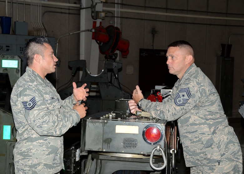 On his recent tour of the Missouri Air National Guard's 131st Bomb Wing at Whiteman Air Force Base, Missouri State Command Chief Master Sgt. Joe Sluder (right) visits the weapons load trainer dock.  There he is briefed on B-2 weapons capabilities and operations by Tech. Sgt. Ricardo Zuniga, a 131st Maintenance Group weapons specialist. (U.S. Air National Guard photo by Airman 1st Class Halley Burgess)