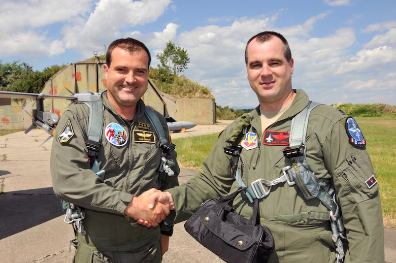 Bulgarian air force MiG-29 pilot Capt. Ivan Dinkov, left, shakes hands with U.S. Air Force F-16 pilot Lt. Col. Matthew Crill after a successful familiarization flight in a two-seat, F-16D Fighting Falcon, from the 177th Fighter Wing of the New Jersey Air National Guard, during Thracian Star at Graf Ignatievo Air Base, Bulgaria, July 15, 2015. Thracian Star is a bilateral training exercise to enhance interoperability with the Bulgarian air force and to bolster readiness to conduct combined air operations. Pilots from both countries benefit from familiarization flights in each other's fighter jets. (U.S. Air National Guard photo by Master Sgt. Andrew J. Moseley/Released)