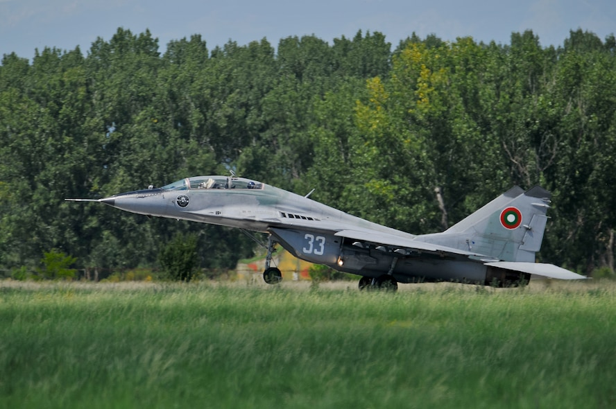A Bulgarian air force MiG-29 Fulcrum takes off with a U.S. Air Force F-16 pilot from the New Jersey Air National Guard in the back seat for a familiarization flight during Thracian Star at Graf Ignatievo Air Base, Bulgaria, on July 15, 2015. Airmen and F-16s from the 177th Fighter Wing flew sorties with the Bulgarian air force in the bilateral training exercise, designed to enhance interoperability. Some MiG-29, MiG-21 and F-16 pilots from each country were afforded the opportunity to fly in each other's jets and observe their capabilities. (U.S. Air National Guard photo by Master Sgt. Andrew J. Moseley/Released)