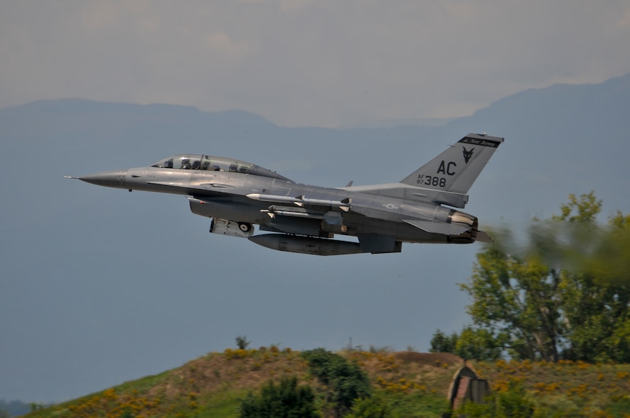 A U.S. Air Force F-16D Fighting Falcon from the New Jersey Air National Guard's 177th Fighter Wing retracts its landing gear after takeoff at Graf Ignatievo Air Base, Bulgaria, during Thracian Star on July 15, 2015. Bulgarian air force MiG-29 pilot Capt. Ivan Dinkov experienced the performance of the aircraft from the back seat during a familiarization flight. Thracian Star is a bilateral training exercise to enhance interoperability with the Bulgarian air force.   (U.S. Air National Guard photo by Master Sgt. Andrew J. Moseley/Released)