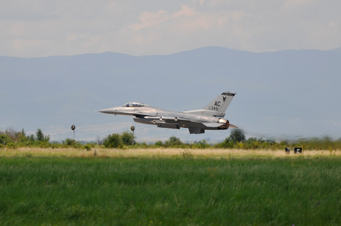 U.S. Air Force F-16C Fighting Falcon from the New Jersey Air National Guard's 177th Fighter Wing rotates takes off from the runway at Graf Ignatievo Air Base, Bulgaria, during Thracian Star on July 15, 2015. Thracian Star is a bilateral training exercise to enhance interoperability with the Bulgarian air force. (U.S. Air National Guard photo by Master Sgt. Andrew J. Moseley/Released)
