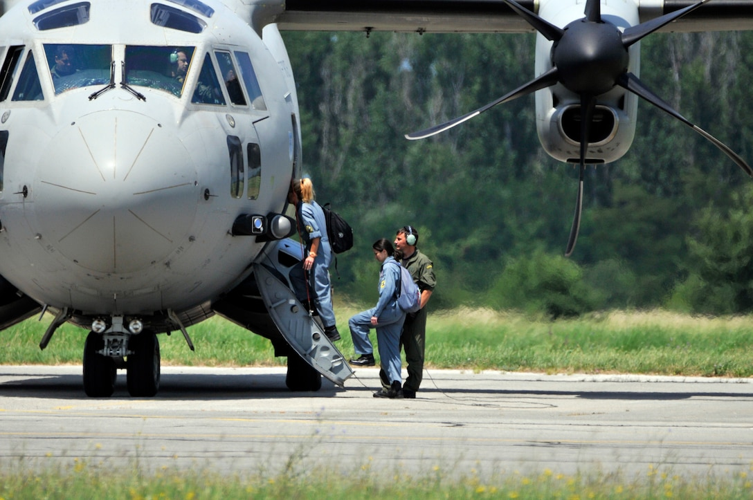 Bulgarian air force crew members board a C-27J Spartan cargo aircraft at Graf Ignatievo Air Base, Bulgaria during Thracian Star on July 14, 2015. Airmen and F-16s from the 177th Fighter Wing of the New Jersey Air National Guard also participated in Thracian Star, a robust training opportunity and exercise with Bulgaria which focused on maintaining readiness while building interoperability capabilities. (U.S. Air National Guard photo by Master Sgt. Andrew J. Moseley/Released)