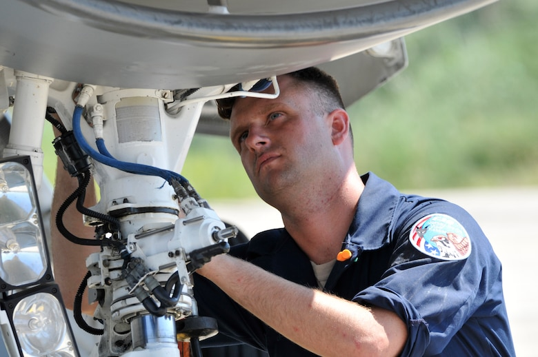 U.S. Air Force Senior Airman Christian Mirande, crew chief with the 177th Fighter Wing of the New Jersey Air National Guard, performs a strut servicing in conjunction with his basic post flight inspection on an F-16D Fighting Falcon at Graf Ignatievo Air Base, Bulgaria, on July 13, 2015. Mirande and approximately 150 airmen from the 177th FW are participating in Thracian Star, a bilateral training exercise to enhance interoperability with the Bulgarian air force and to bolster readiness to conduct combined air operations. (U.S. Air National Guard photo by Master Sgt. Andrew J. Moseley/Released)