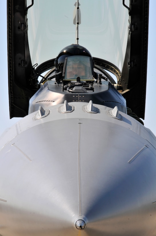 U.S. Air Force Lt. Col. Philippe Malebranche, F-16 pilot with the 177th Fighter Wing, prepares to start the turbine engine, close the canopy and taxi his Fighting Falcon to take off on a training mission during Thracian Star, a bilateral training exercise to enhance interoperability with the Bulgarian air force, at Graf Ignatievo Air Base, Bulgaria, on July 13, 2015. (U.S. Air National Guard photo by Master Sgt. Andrew J. Moseley/Released)